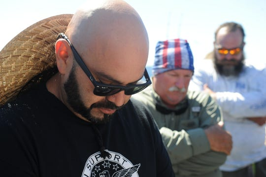 Manny Lopez of Oxnard, a Marine Corps veteran, prays along with about 50 other veterans during a recent fishing trip to Anacapa Island. Anglers Anonymous organized the trip.