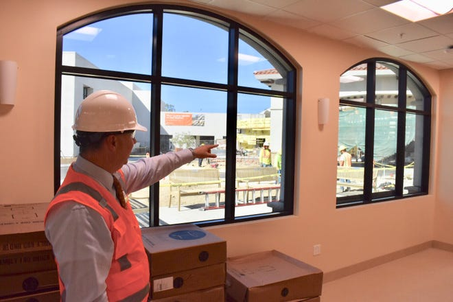 St. John's Pleasant Valley CEO Darren Lee leads a tour in the new hospital that is expected to open for patients before Thanksgiving.