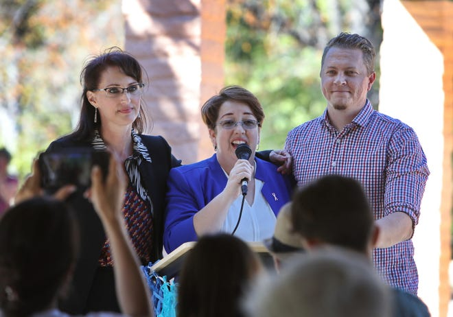 Simi Valley mayoral candidate Dawn Gray (left) and City Council candidates Ruth Luevanos and Phil Loos address the crowd at the Hispanic Heritage Celebration on Sunday at Rancho Simi Community Park.