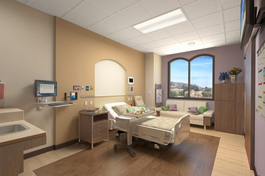 The rooms at the new St. John's Pleasant Valley Hospital in Camarillo include larger TVs, a reclining chair and a sleeper sofa.