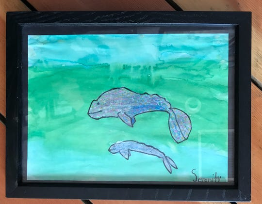 Serenity Rayne Holmes, 6, created this watercolor of two whales when she was in kindergarten.