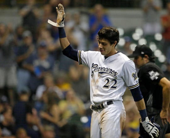 Westlake High graduate Christian Yelich acknowledges the crowd after receiving a standing ovation for hitting for the cycle during the Brewers' win over the Reds in Milwaukee on Monday night. It was Yelich's second cycle this season against Cincinnati.