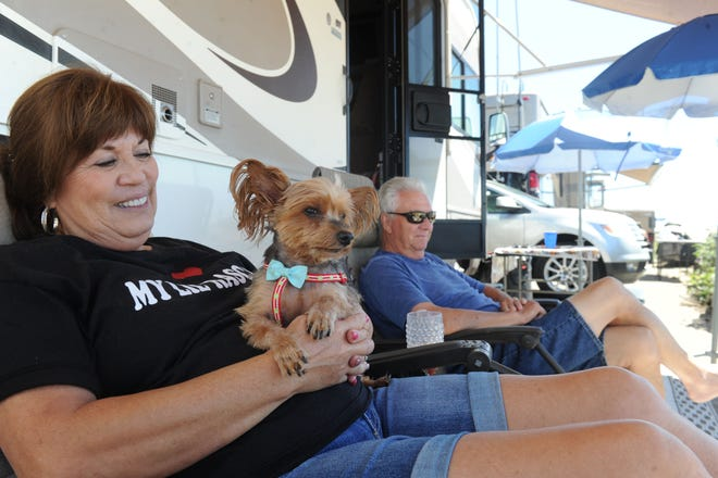 Jerri and Tom Hooten, of Oak View, and their dog Little Rascal hang out at Rincon Parkway along Pacific Coast Highway. As of Nov. 1 reservations will be needed at popular camping spots along the ocean at Rincon, Faria and Hobson beaches.