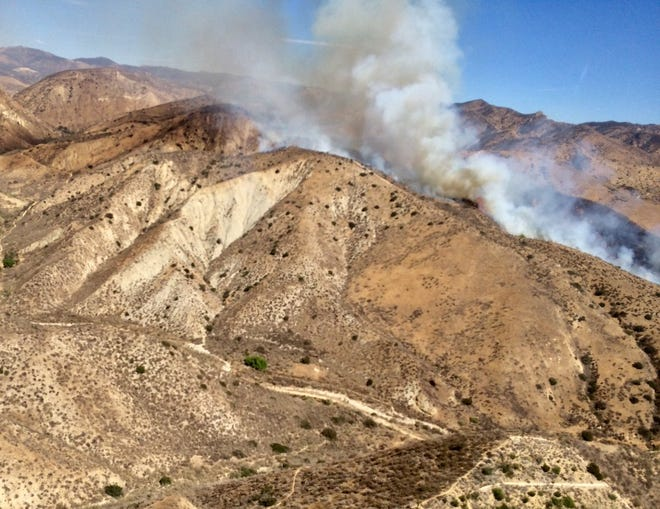 Smoke rises from a brush fire in Simi Valley's Las Llajas Canyon Tuesday afternoon.
