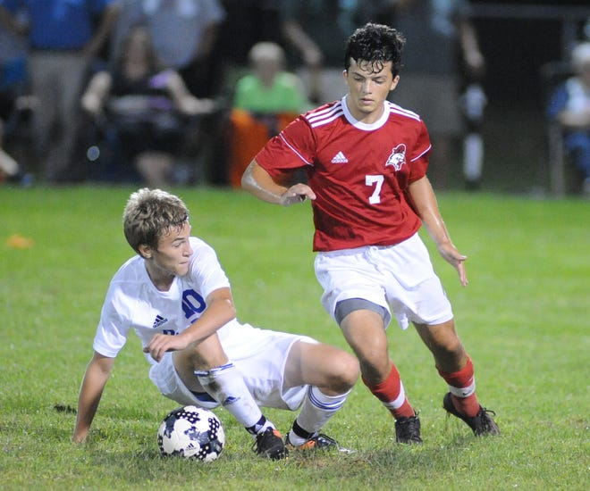 Vineland's Cameron Stahl pushes off Millville's Josh Dion as he goes for the ball during a boys soccer game at Romano Sports Complex in Vineland, Monday, Sept. 17, 2018.