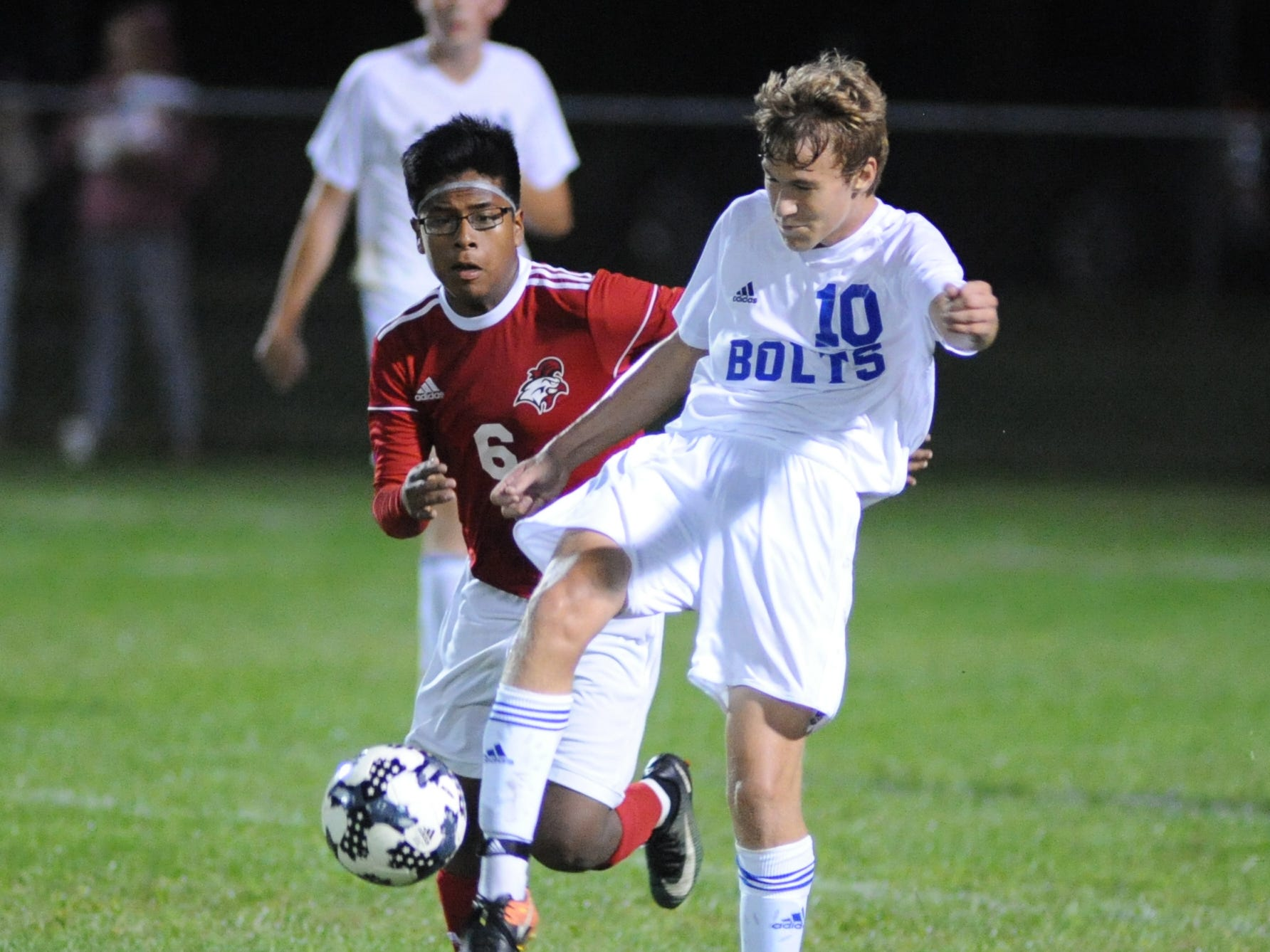 Millville's Josh Dion moves the ball with Vineland's Jonathan David defending during a boys soccer game at Romano Sports Complex in Vineland, Monday, Sept. 17, 2018.