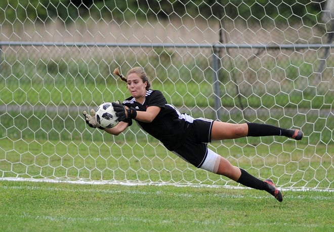 Vineland's keeper Isabella Fiorenza makes a  diving save on a Millville shot during a girls soccer game at Romano Sports Complex in Vineland on Monday, Sept. 17, 2018.