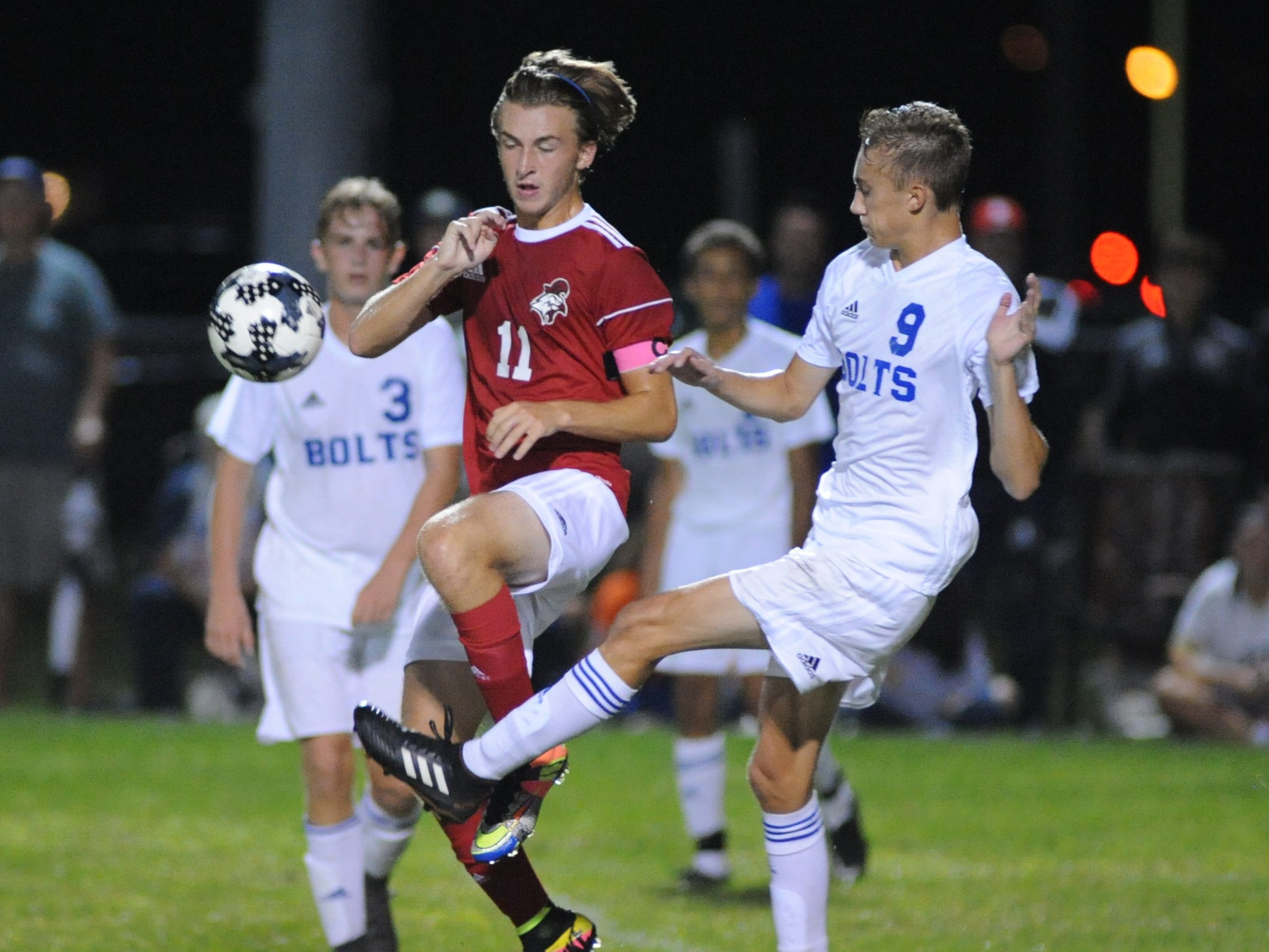 Millville's William Muhlbaier kicks the ball with Vineland's Lucas Portadin defending during a boys soccer game at Romano Sports Complex in Vineland, Monday, Sept. 17, 2018.
