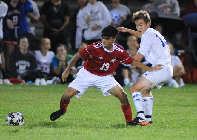 Vineland's Usmar Barrera moves the ball with Millville's Josh Dion defending during a boys soccer game at Romano Sports Complex in Vineland, Monday, Sept. 17, 2018.