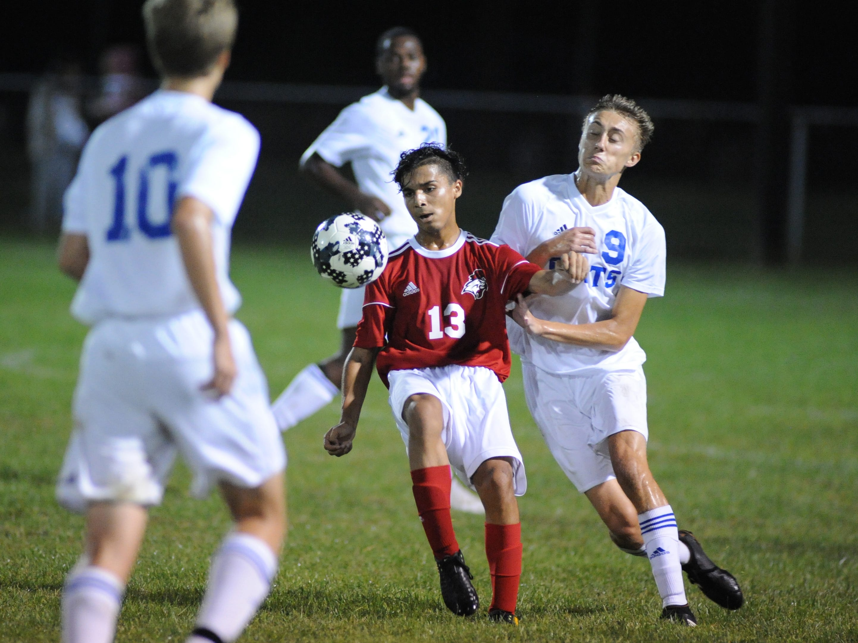 Vineland's Usmar Barrera moves the ball with Millville's William Muhlbaier defending during a boys soccer game at Romano Sports Complex in Vineland, Monday, Sept. 17, 2018.