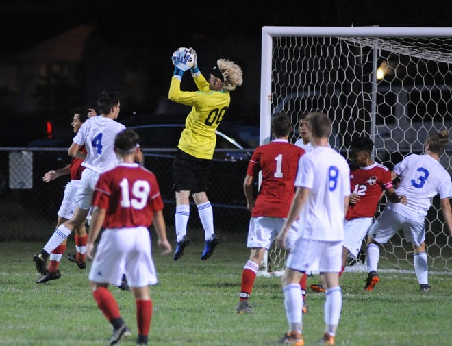Millville's keeper Nate Goranson makes a save during a boys soccer game against Vineland at Romano Sports Complex in Vineland, Monday, Sept. 17, 2018.