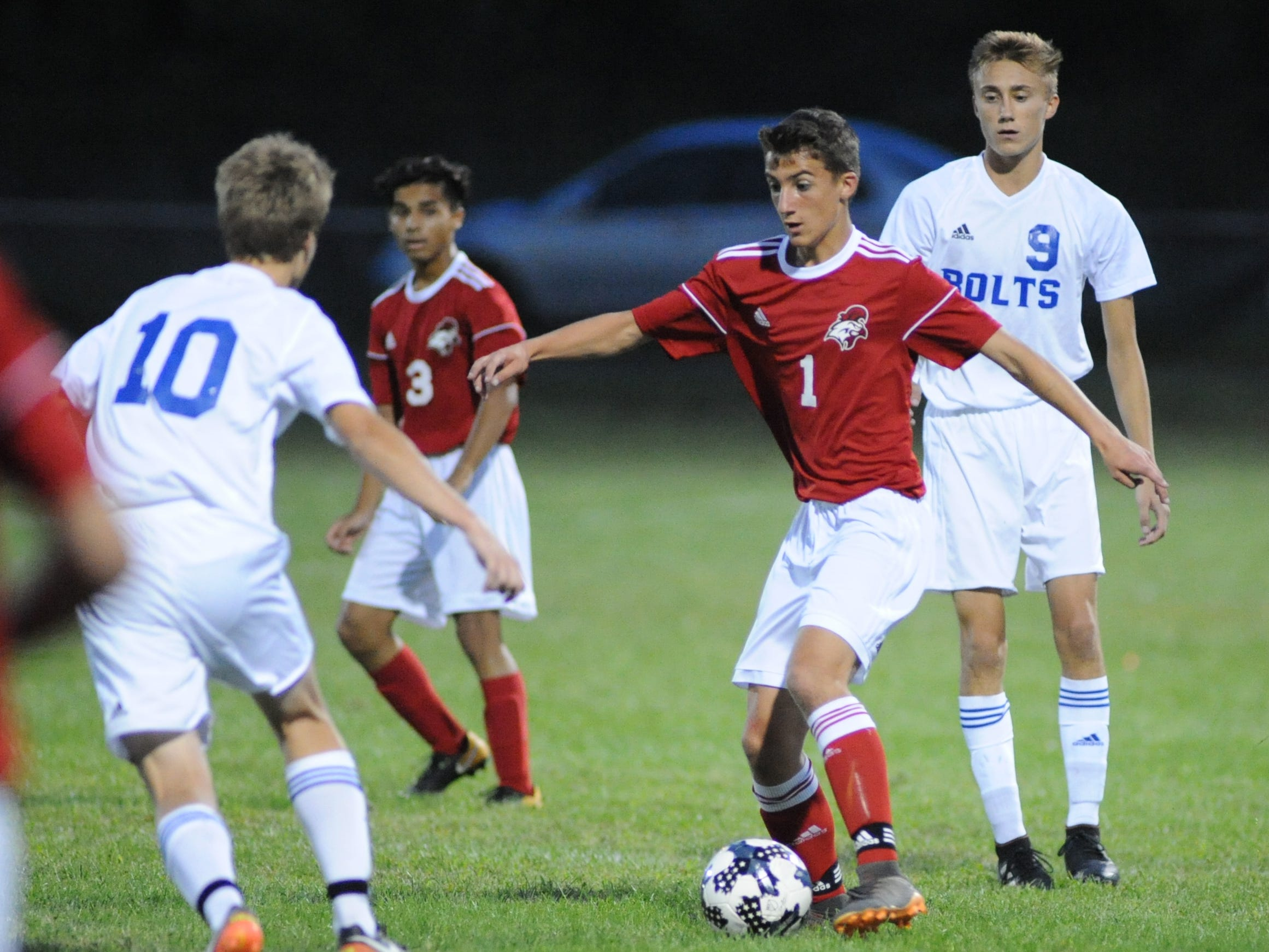 Vineland's Jude Hill moves the ball during a boys soccer game against Millville at Romano Sports Complex in Vineland, Monday, Sept. 17, 2018.