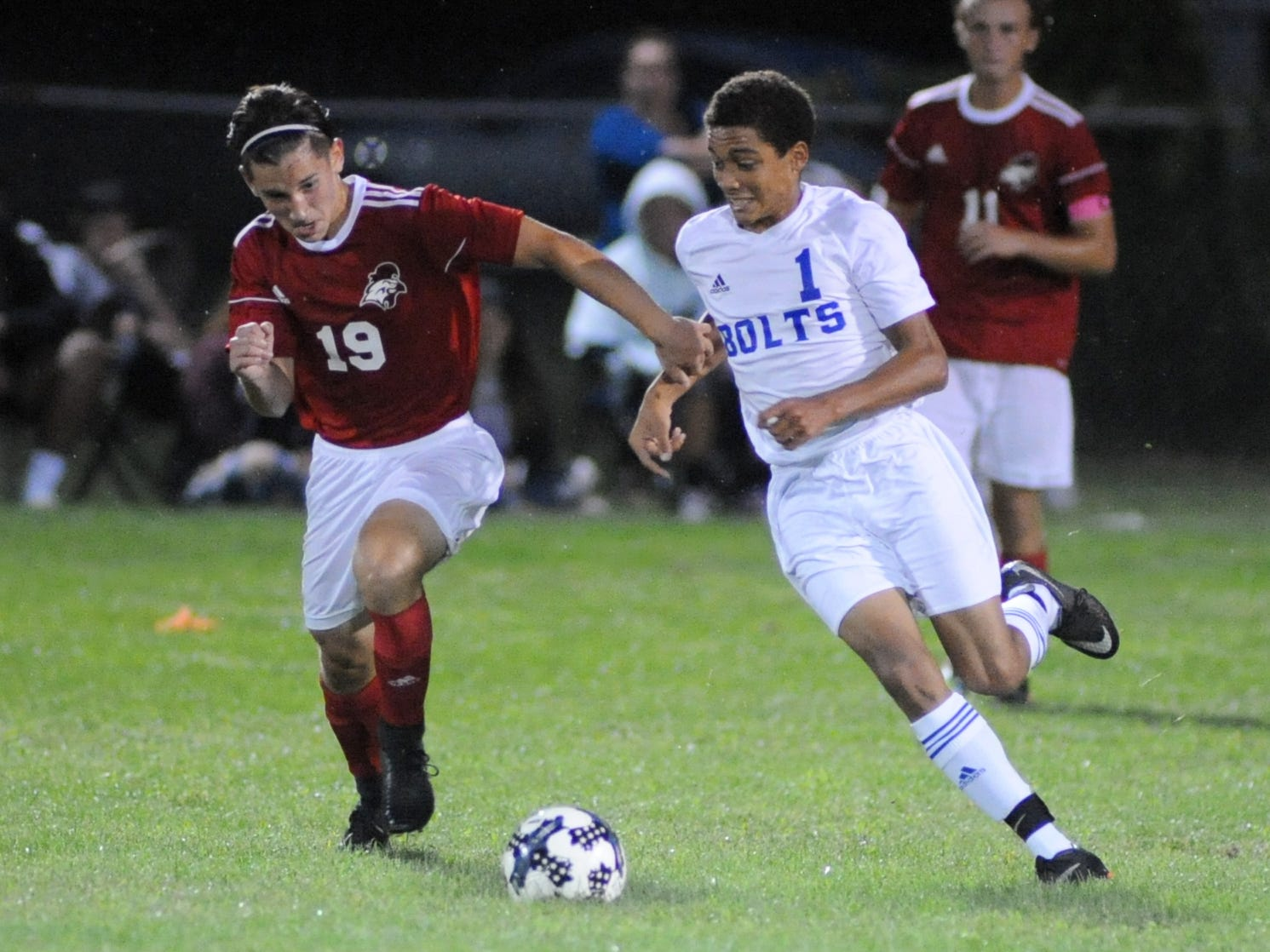 Vineland's David Singer and Millville's Treshan Stevenson race to the ball during a boys soccer game at Romano Sports Complex in Vineland, Monday, Sept. 17, 2018.