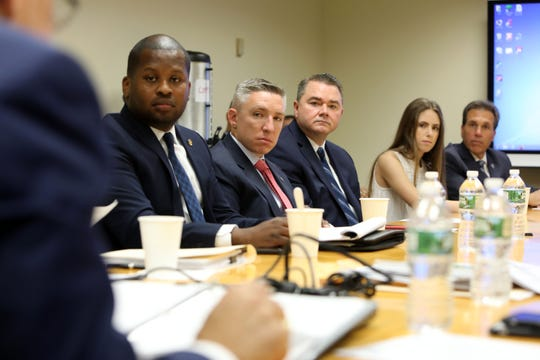 Members of law enforcement, school security and a student attend the School Safety Commission's inaugural meeting Sept. 18, 2018 at the Westchester County District Attorney's Office in White Plains.