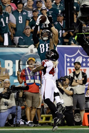Philadelphia Eagles' Dallas Goedert (88) cannot catch a pass in the end zone over Atlanta Falcons' Duke Riley (42) during the first half of an NFL football game Thursday, Sept. 6, 2018, in Philadelphia. (AP Photo/Michael Perez)