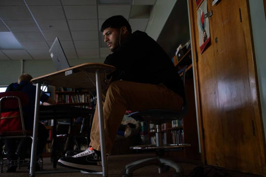 Jose Gavina, 19, a senior at Sarah Pyle Academy, works on math in during his English class. The school has a flexible model of blended learning, where students use technology to set their own pace.