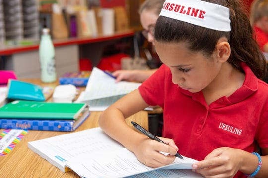 Ursuline's small classroom sizes allow students to engage deeply with the subject matter.