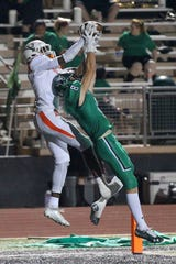Jacob Williams pulls down a third-quarter touchdown catch over Iowa Park's Kase Johnson Friday night.