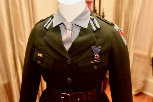 """The uniforms are display through November 11 at the Kell House Museum as part of its """"A League of Honour: Wichita Falls & World War I"""" exhibit."""