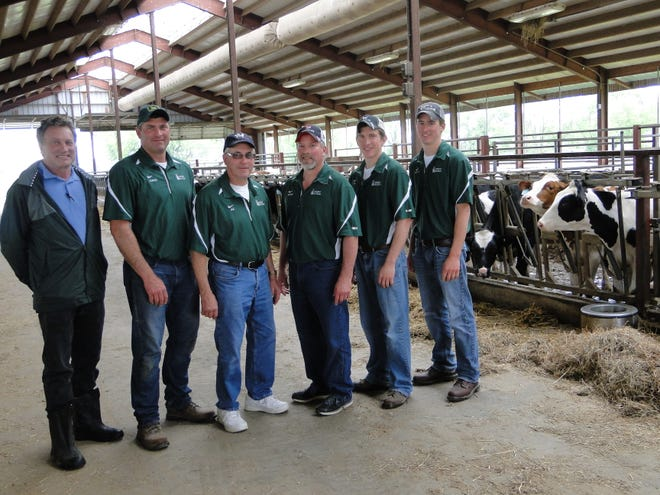 The Hildebrandt family and their nutritionist Brian Gerloff (left) are part of a venture creating cheese from the milk produced on the Hildebrandt farm at Hustisford.  Cheese is made by artisans in four different southern Wisconsin cheese plants and direct marketed at farmers markets and to restaurants in the Chicago area and southern Wisconsin.  From left, Gerloff, Jared Hildebrandt, Al Hildebrandt, Roger Hildebrandt, Ty Hildebrandt and Brett Hildebrandt