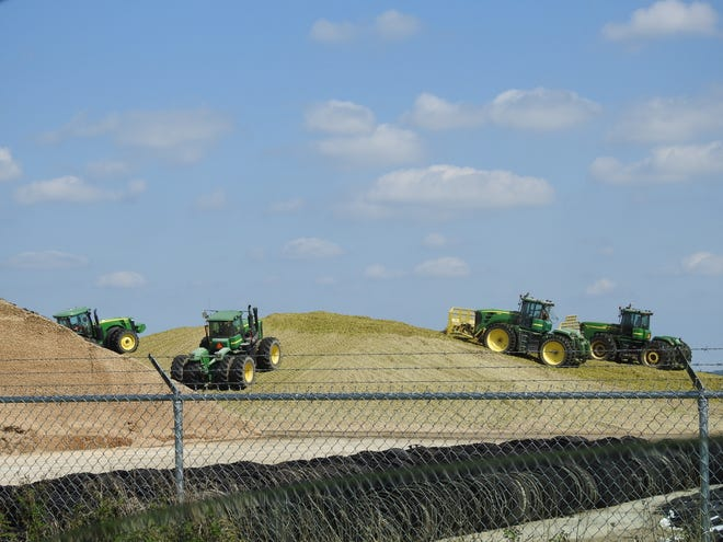 Four tractors work in concert to pack this feed pile on a Sheboygan County farm.
