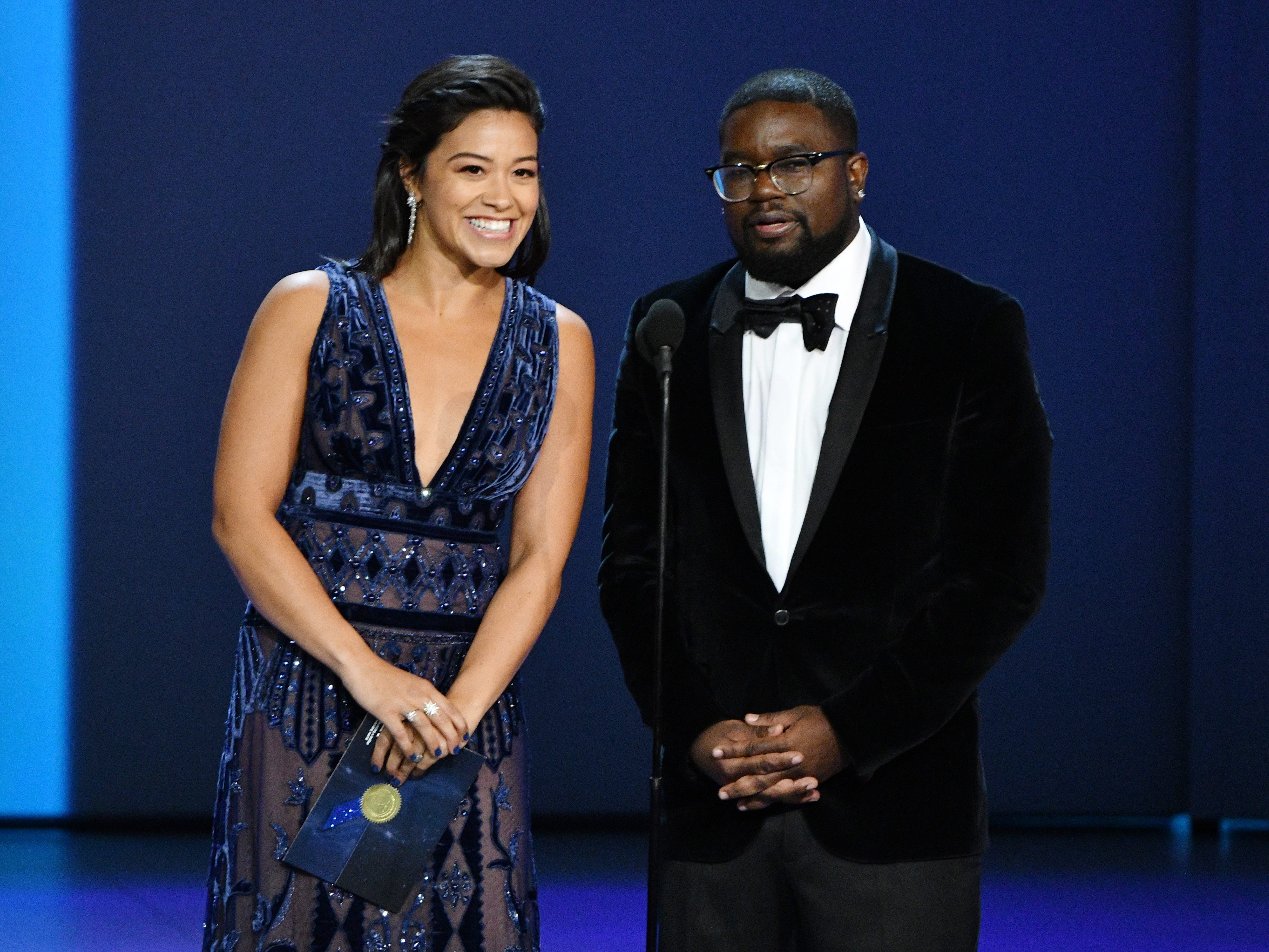 Gina Rodriguez, left, and Lil Rel Howery present the award for outstanding writing for a drama series.