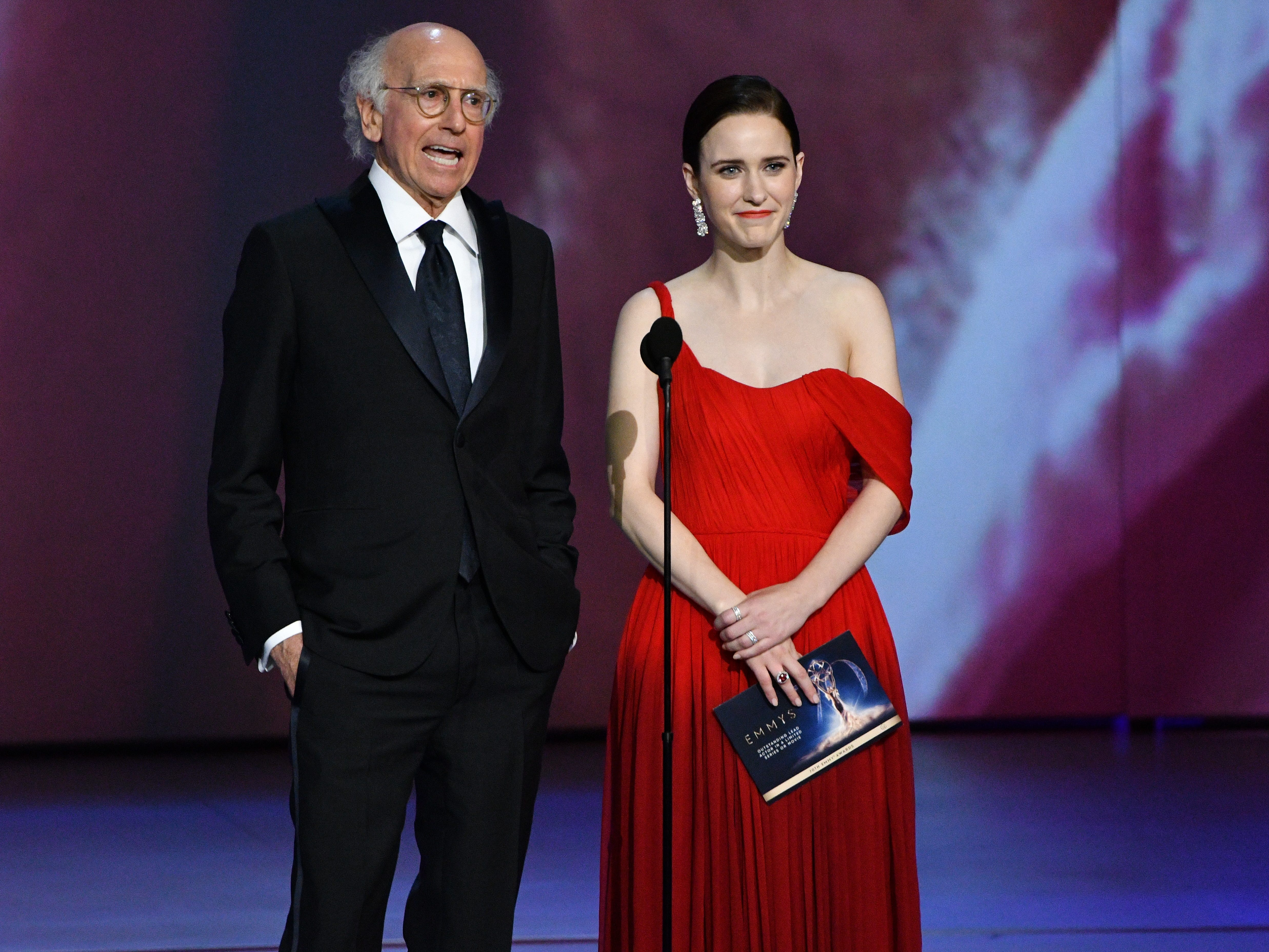 Larry David and Rachel Brosnahan present the award for lead actor in a limited series or movie.