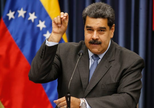 Venezuela's President Nicolas Maduro demonstrates his Salt Bae sprinkling technique during a press conference at the Miraflores Presidential Palace, in Caracas, Venezuela, Tuesday, Sept. 18, 2018. Maduro demonstrated the technique after speaking about the invitation to the famed Nusr-Et steakhouse in Istanbul when he stopped over briefly in Turkey on the way home from a trip to China.