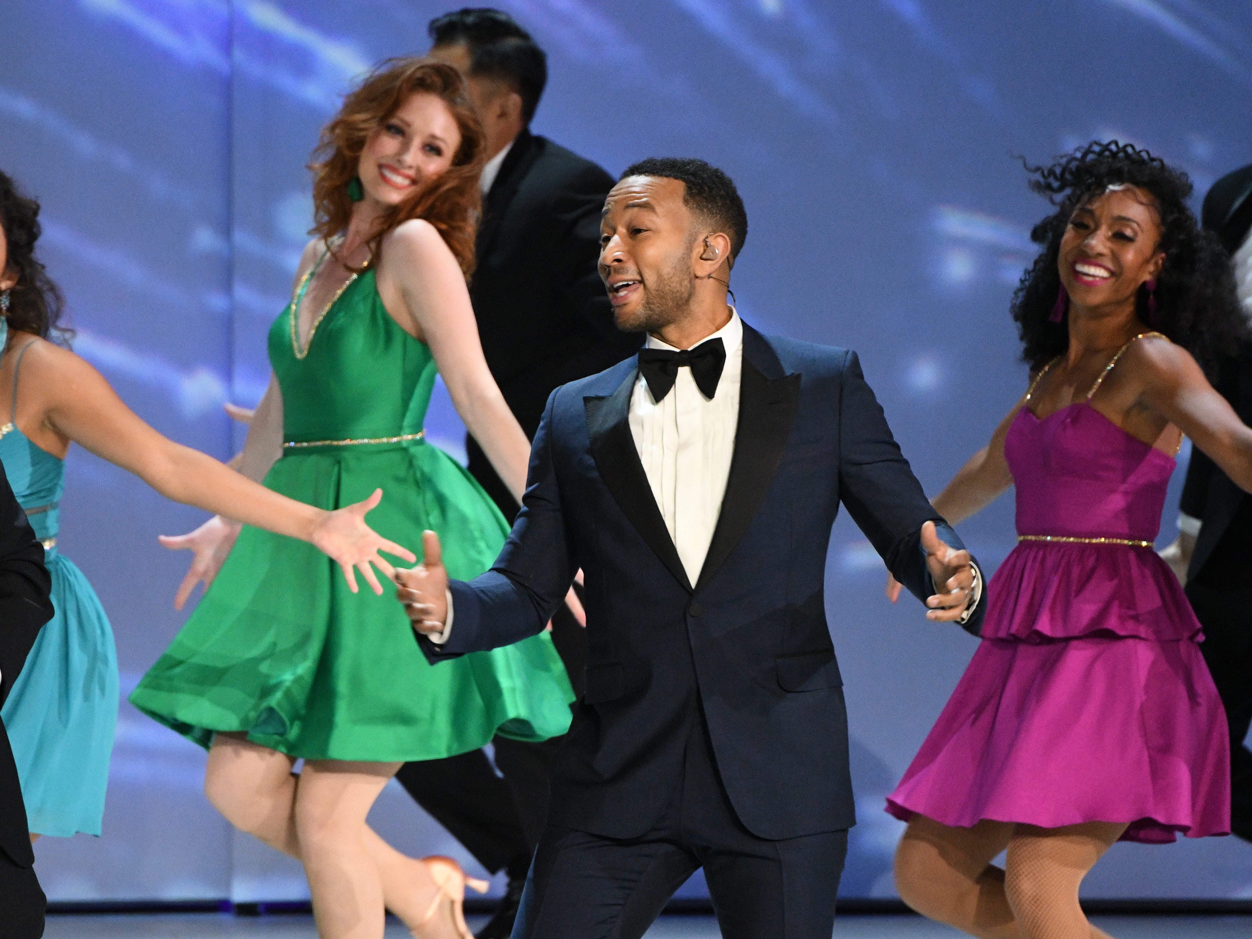 """John Legend performs """"We Solved It"""" during the show opening."""