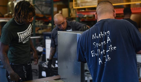 """Homeboy Electronics Recycling, located in a warehouse in downtown Los Angeles, dismantles and shreds discarded electronics. Launched in 2011 as Isidore Electronics Recycling, the for-profit business was acquired in 2016 and renamed by Homeboy Industries, a nonprofit that rehabilitates former """"homeboys"""" — gang members and ex-convicts."""