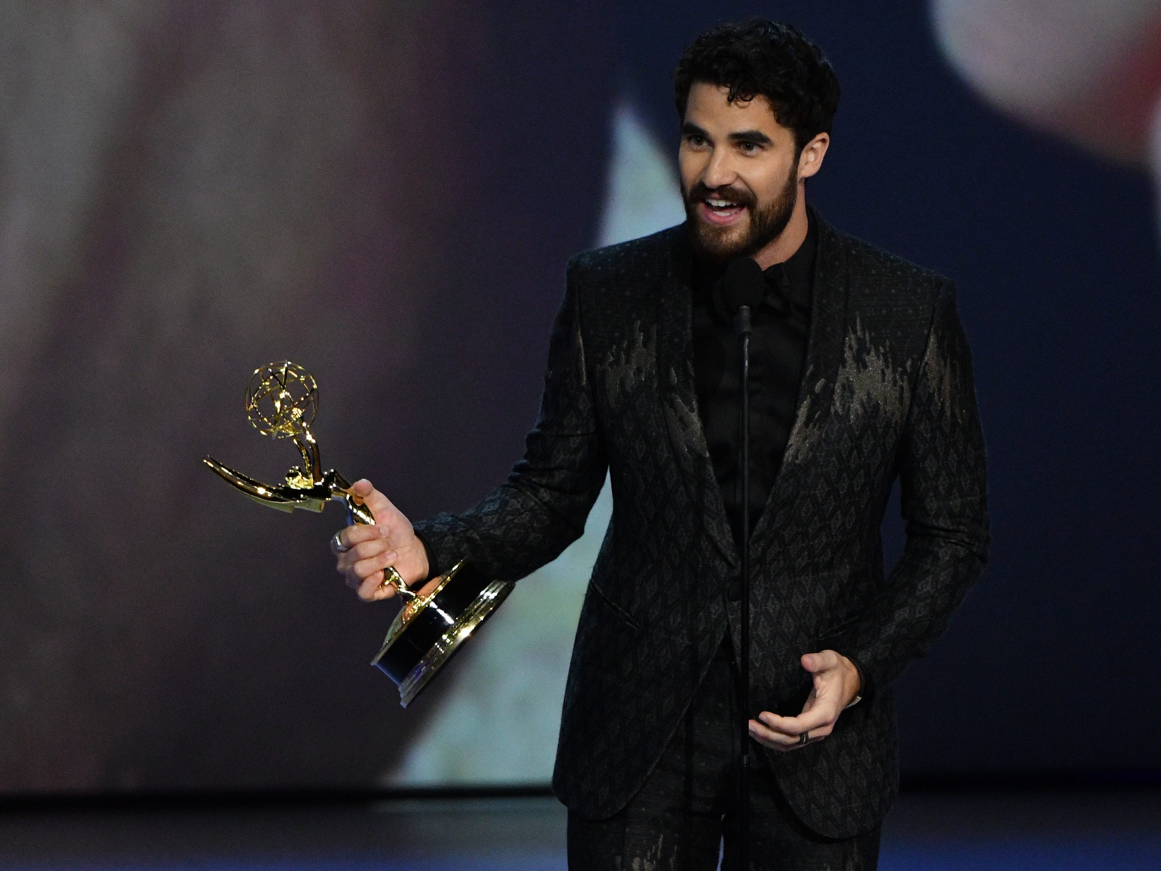 """Darren Criss accepts the award for lead actor in a limited series or movie for his role in """"The Assassination Of Gianni Versace: American Crime Story."""""""