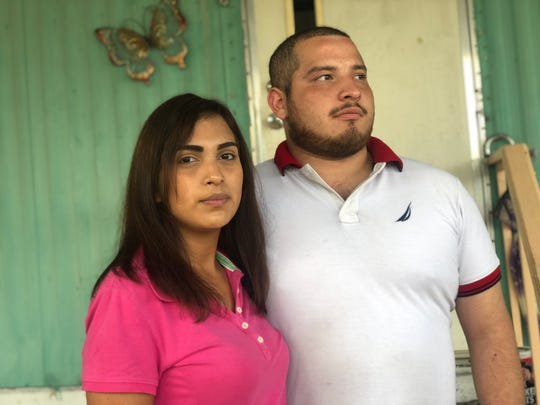 Grisela Perez and Cesar Ramirez, sister-in-law and brother of Border Patrol agent killing spree victim Melissa Ramirez, outside the home of Melissa Ramirez's mother. Melissa Ramirez would often show up to the home with bruises and a split lip from her life on the streets.