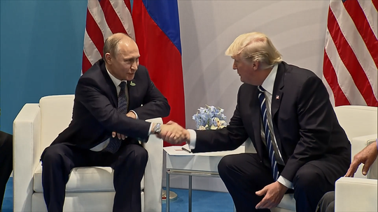 """Russian President Vladimir Putin and U.S. President Donald Trump shake hands in July 2018, as depicted in """"Active Measures."""""""