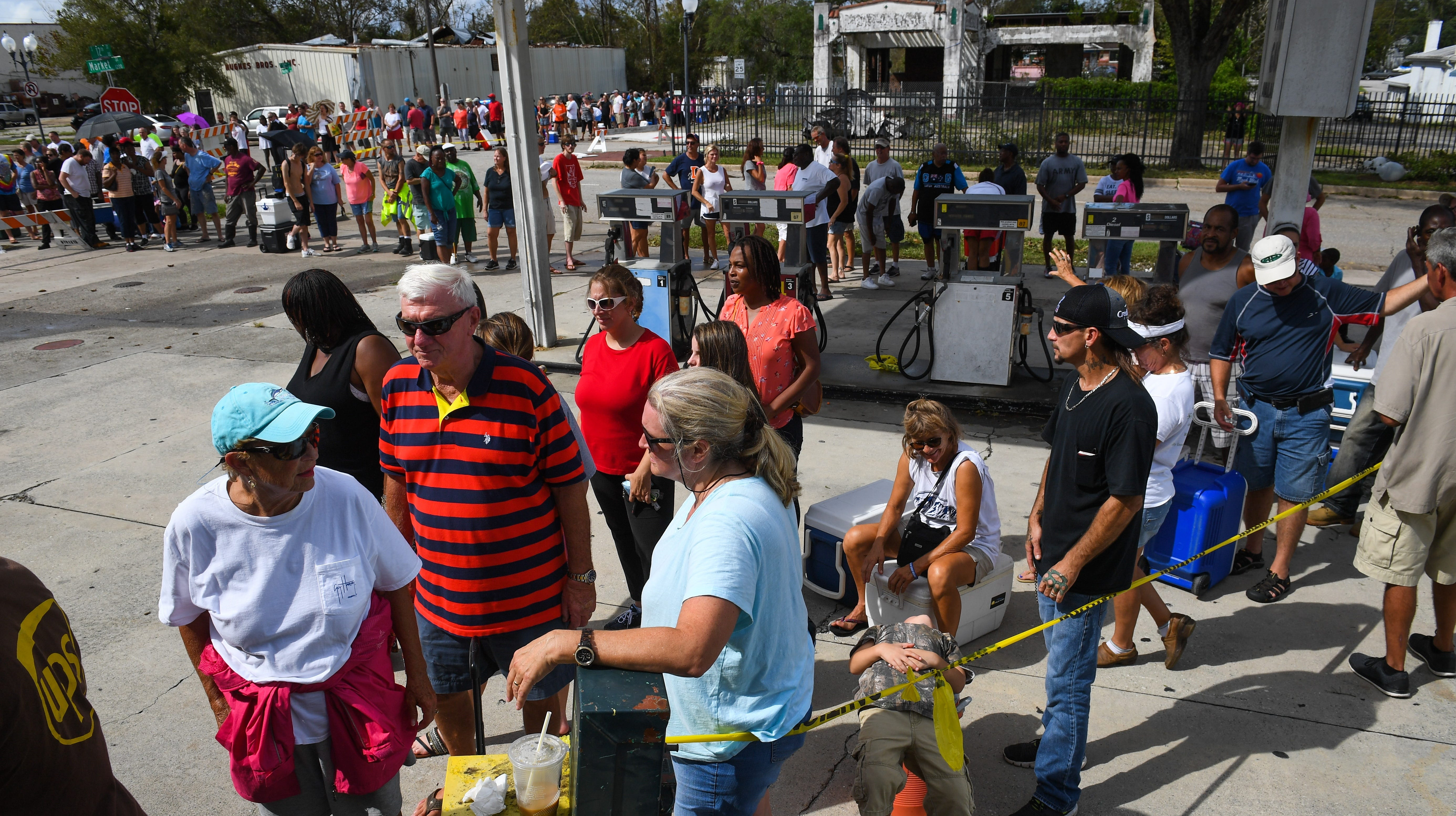 People line up to buy ice waiting to buy ice from The Rose Ice and Coal Company in Wilmington, N.C., on Sept. 17, 2018.