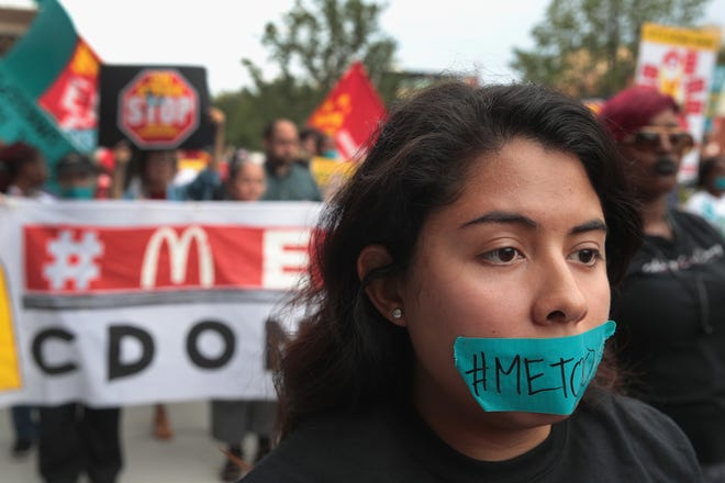 "CHICAGO, IL - SEPTEMBER 18:  McDonald's workers are joined by other activists as they march toward the company's headquarters to protest sexual harassment at the fast food chain's restaurants on September 18, 2018 in Chicago, Illinois. Similar actions which took place around the country and were touted as the first-ever nationwide ""strike"" against sexual harassment in the fast food industry. According to a recent study forty percent of female fast-food workers experience unwanted sexual behavior on the job.  (Photo by Scott Olson/Getty Images) ORG XMIT: 775229631 ORIG FILE ID: 1035627064"