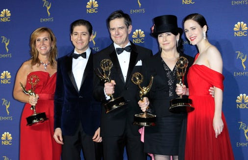 """(The Emmy) is just icing. A lovely icing. A little buttercream,"" Amy Sherman-Palladino, second right, proclaimed after ""The Marvelous Mrs. Maisel"" won the comedy series Emmy."