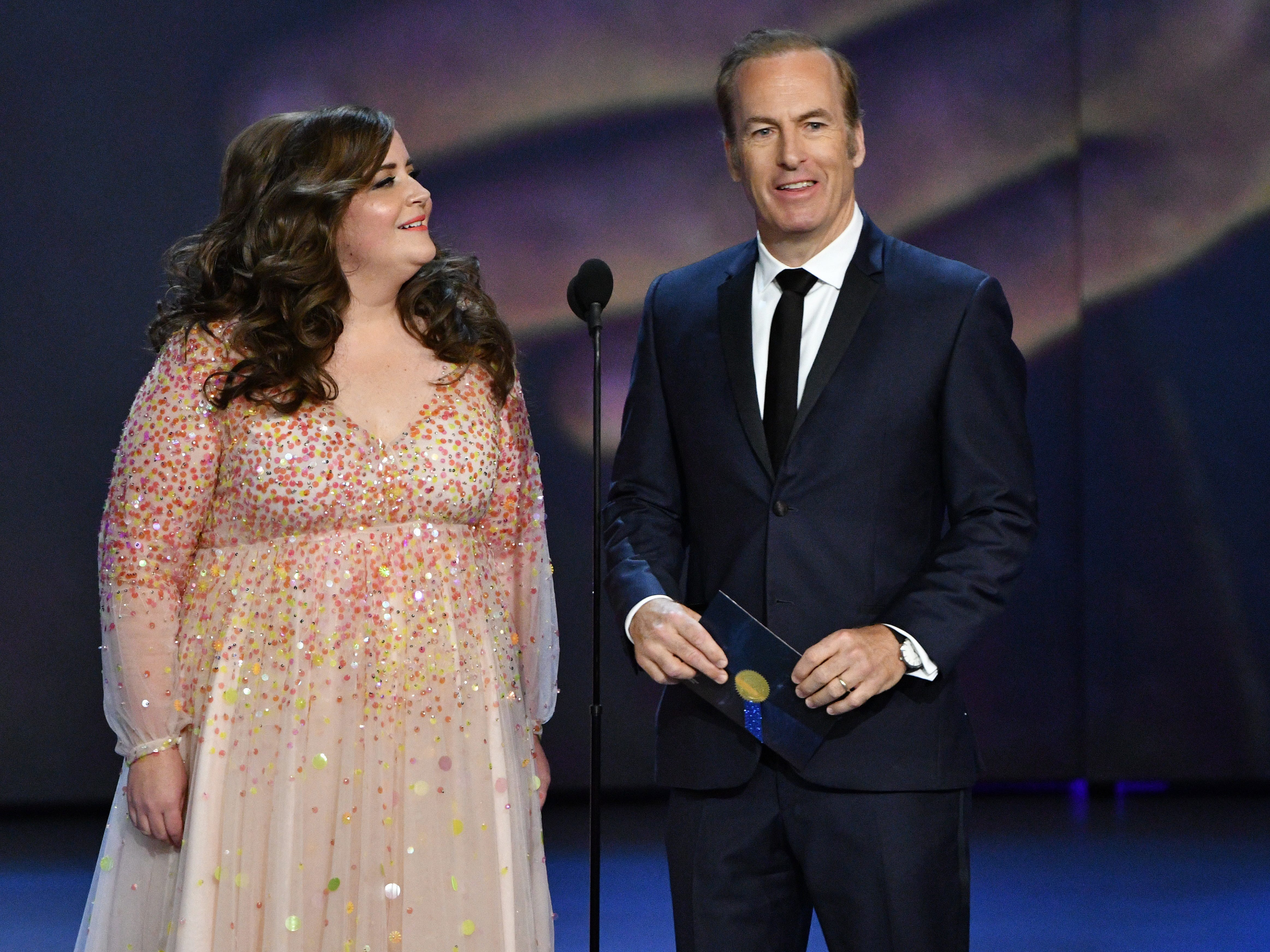 Aidy Bryant, left, and Bob Odenkirk present the award for outstanding writing for a limited series, movie or dramatic special.