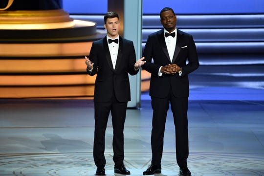 Colin Jost and Michael Che deliver the opening monologue during the 70th Emmy Awards.