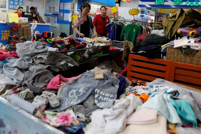 Clothes for sale are displayed in a super market in Beijing, China, on Sept. 18, 2018.  The United States announced Monday they are imposing new tariffs worth 200 billion US dollars on almost 6,000 Chinese goods including handbags, rice and textiles.