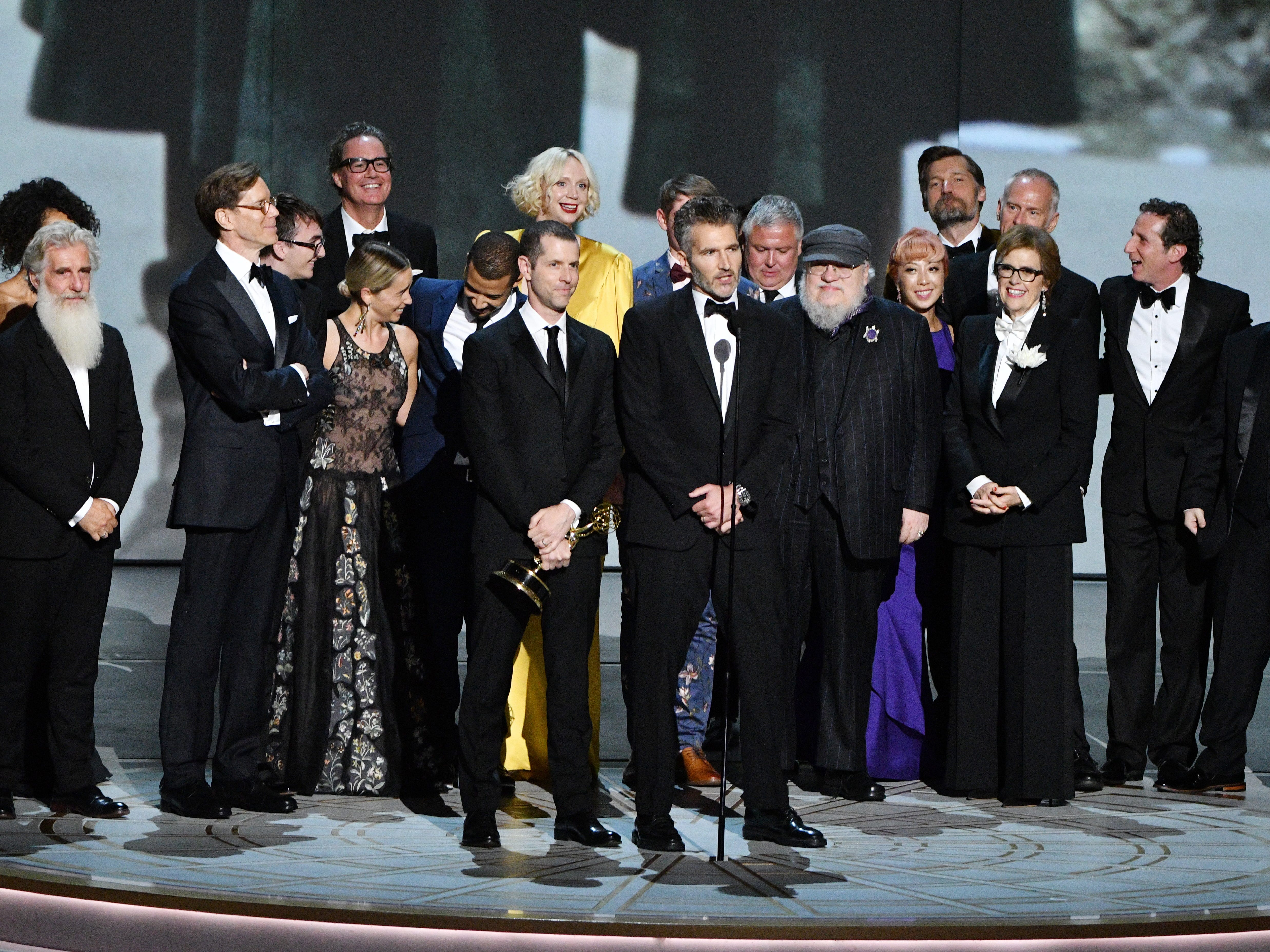 """D.B. Weiss, David Benioff and George R. R. Martin along with the cast and crew of """"Game Of Thrones"""" on HBO accept the award for outstanding drama series."""