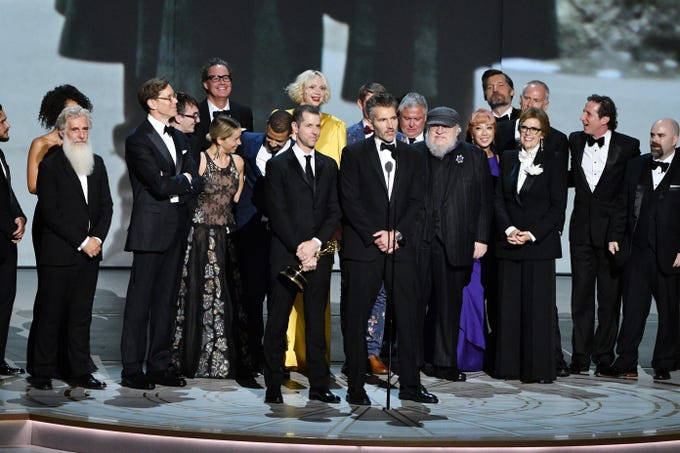 "D.B. Weiss, David Benioff and George R. R. Martin along with the cast and crew of ""Game Of Thrones"" on HBO accept the award for outstanding drama series."