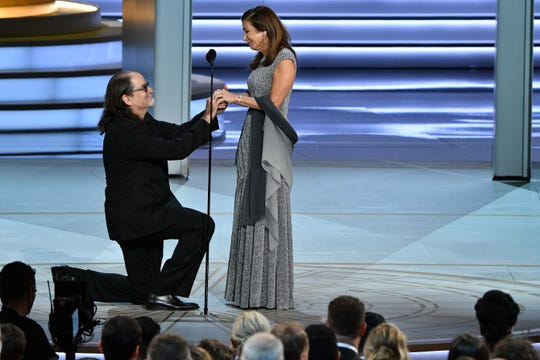 Glenn Weiss proposes to his girlfriend after accepting the award for outstanding directing for a variety special during the 70th Emmy Awards.