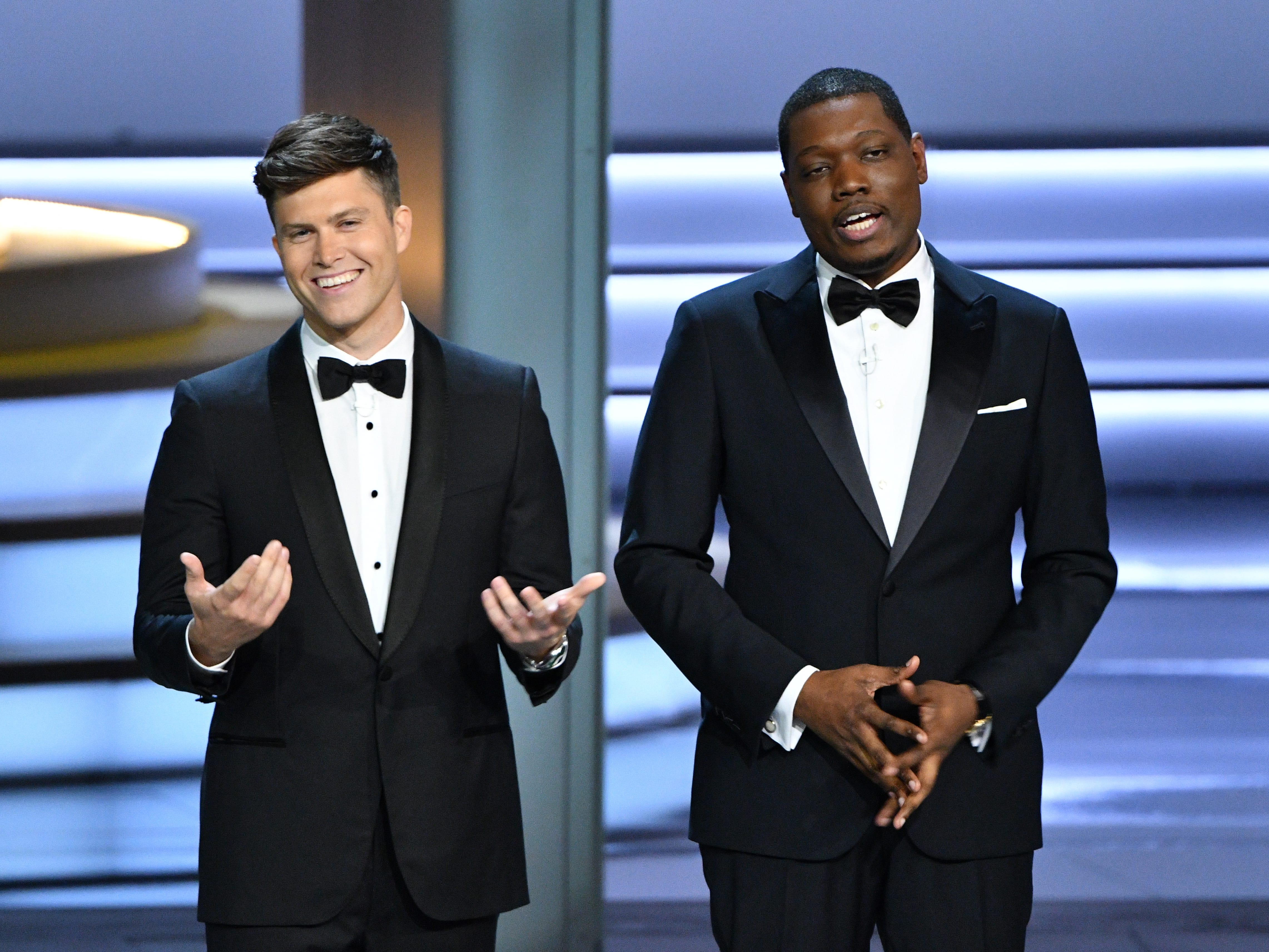 Colin Jost, left, and Michael Che speak during the show.