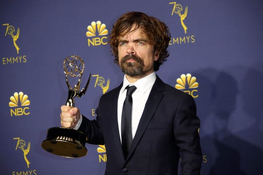 """Peter Dinklage hefts his Emmy for outstanding supporting actor in a drama for """"Game of Thrones."""""""