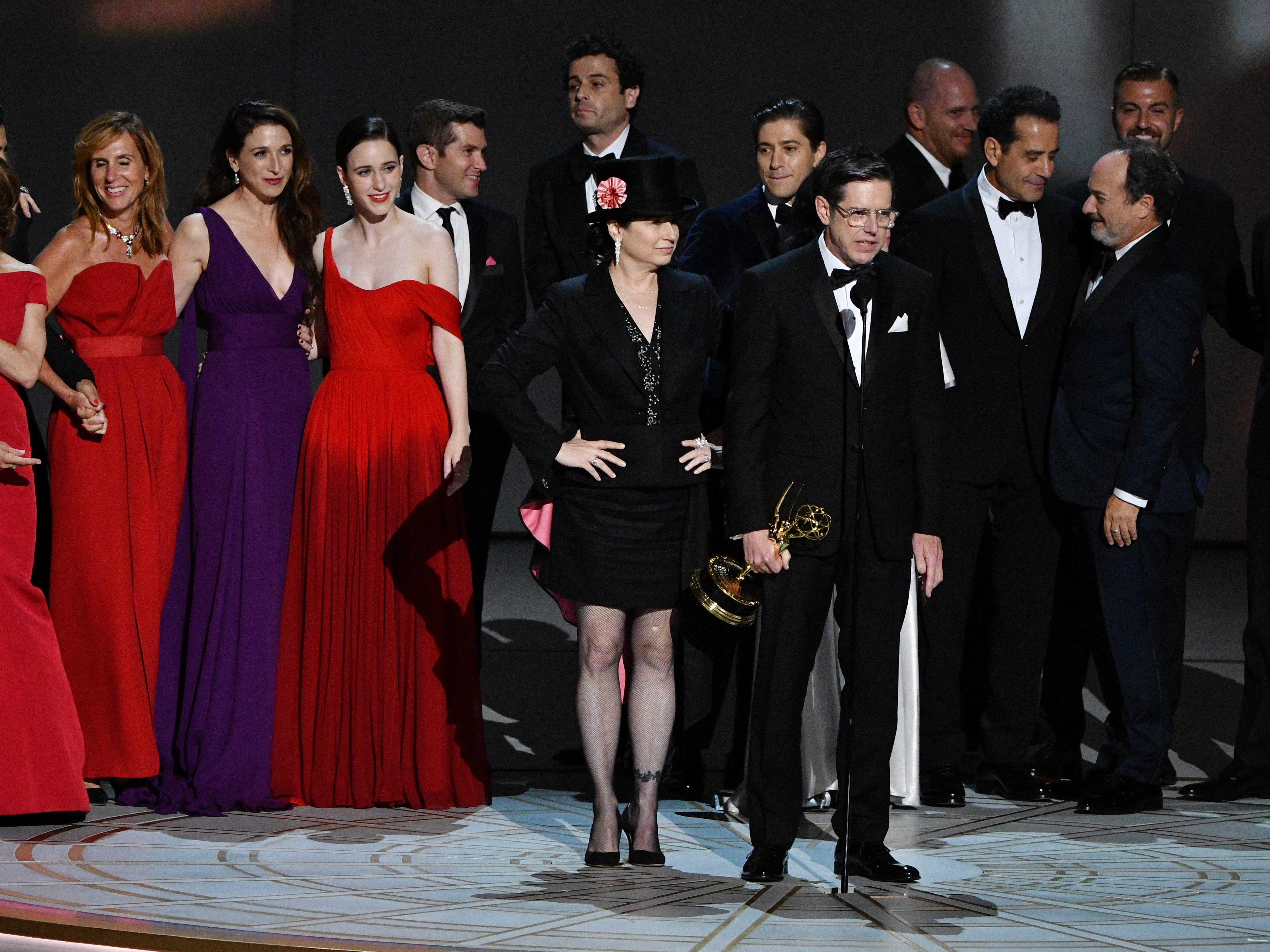 """Amy Sherman-Palladino, Daniel Palladino and the cast and crew of """"The Marvelous Mrs. Maisel"""" on Amazon Prime Video  accept the award for outstanding comedy series."""