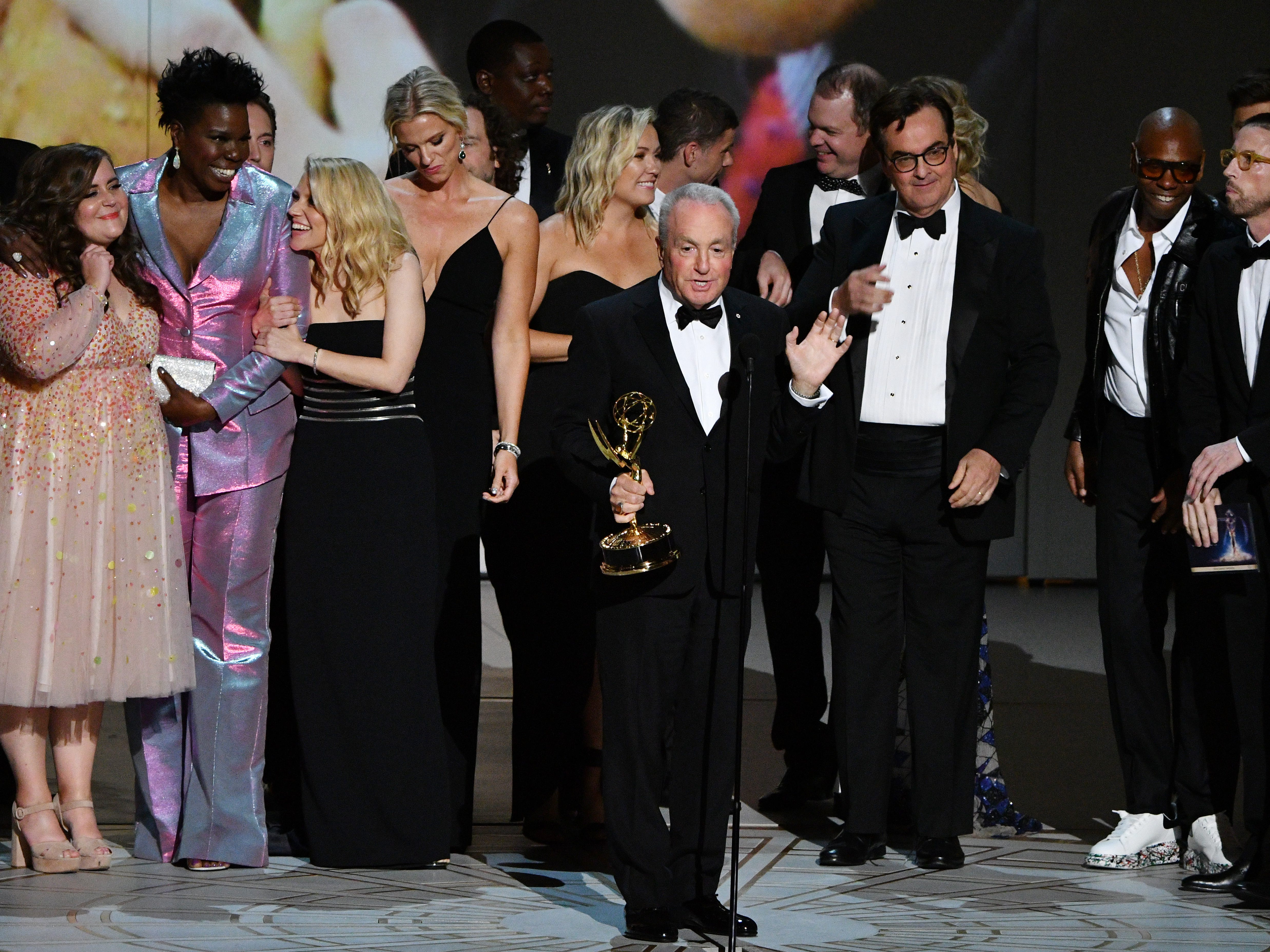 """Lorne Michaels, center, and the cast and crew of """"Saturday Night Live"""" on NBC accept the award for outstanding variety sketch series."""