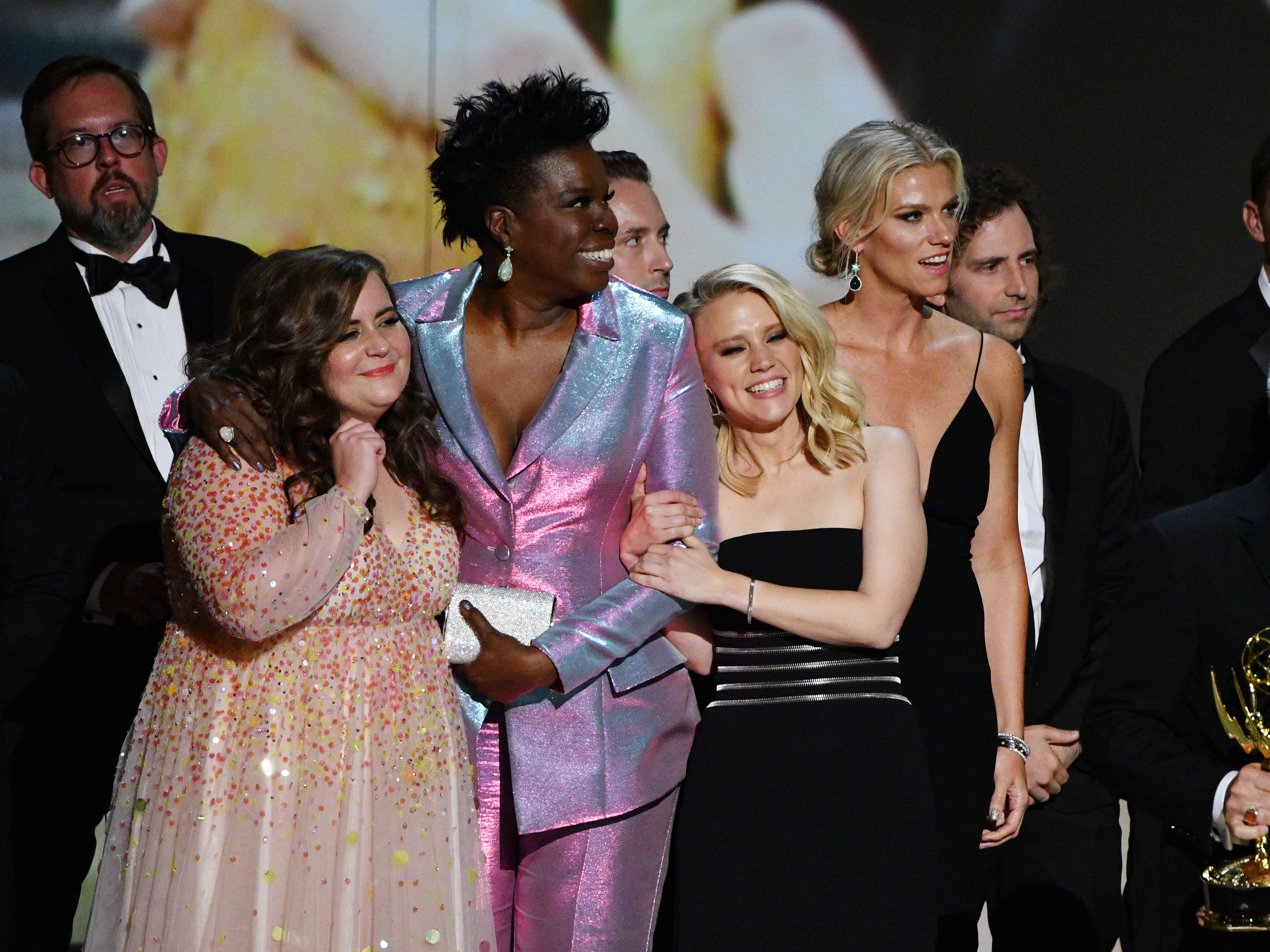 """Aidy Bryant, Leslie Jones and Kate McKinnon join the cast and crew of """"Saturday Night Live"""" on NBC to accept the award for outstanding variety sketch series."""