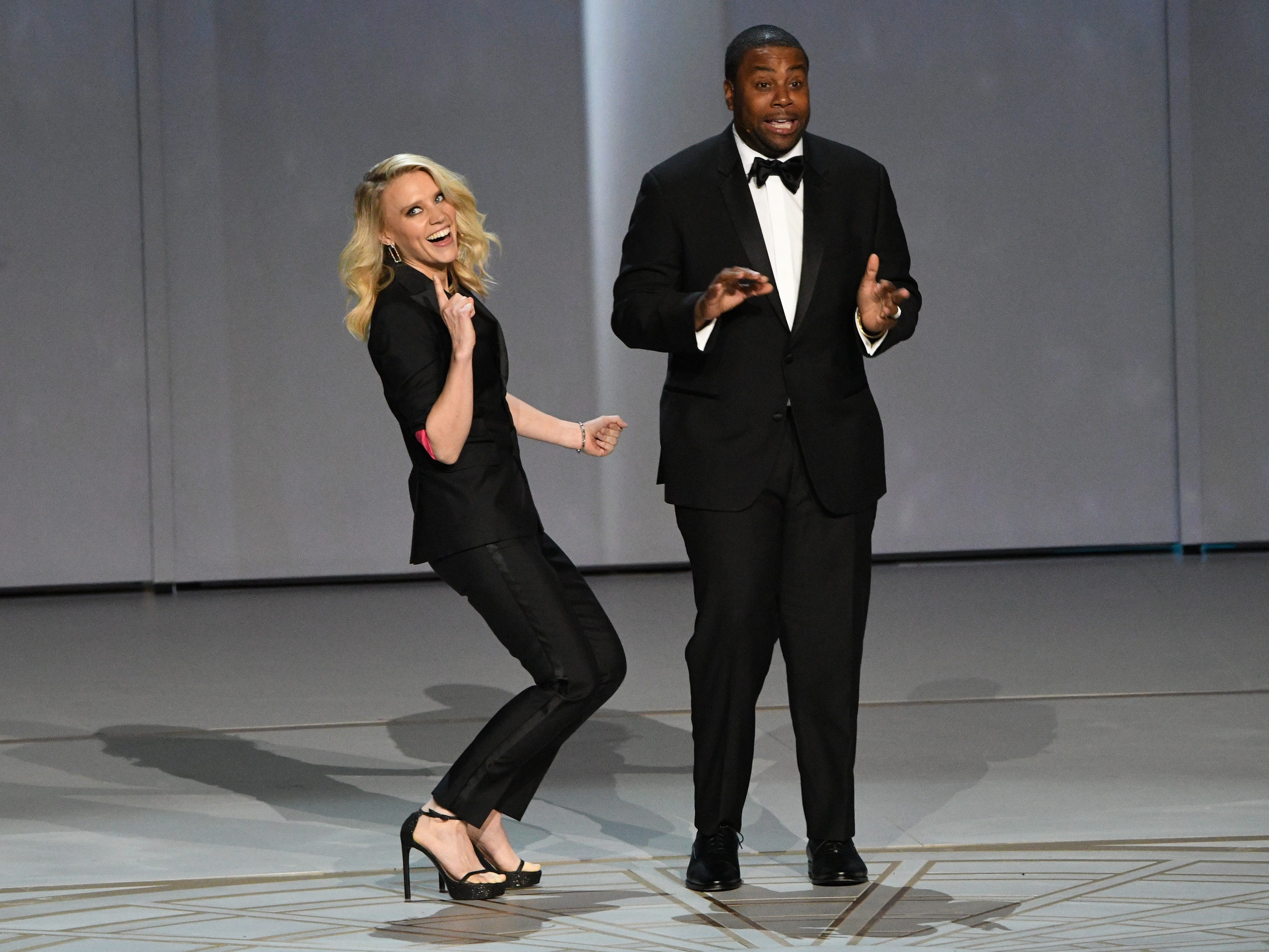 """Kate McKinnon and Kenan Thompson perform """"We Solved It"""" during the show open."""