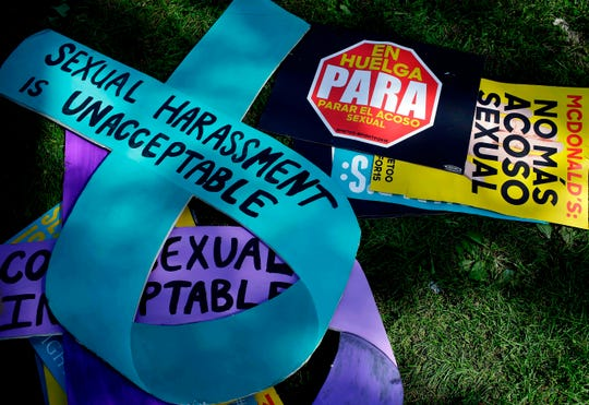 Signs used by McDonald's employees and other fast food chain workers to protest against sexual harassment in the workplace are displayed on the ground on Sept. 18, 2018 in Chicago.