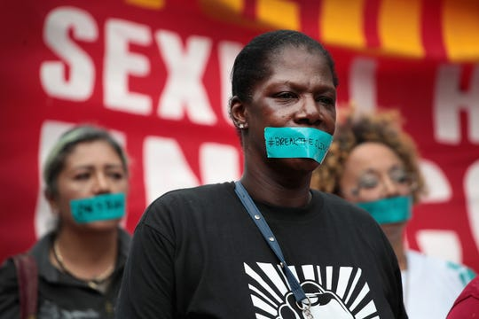 McDonald's workers are joined by other activists as they march toward the company's headquarters to protest sexual harassment at the fast food chain's restaurants on Sept/ 18, 2018 in Chicago.